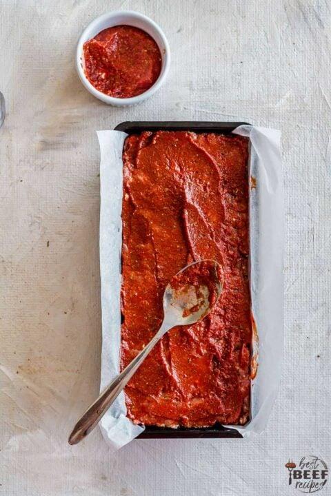Spreading meatloaf glaze on top of keto meatloaf