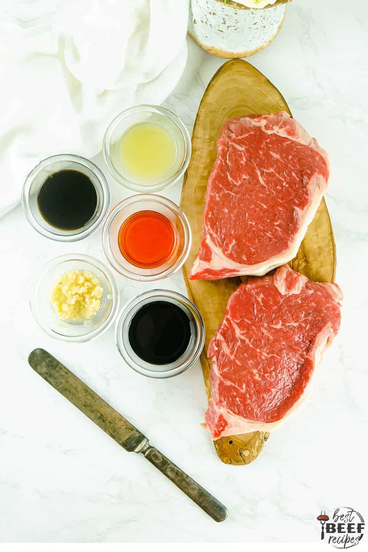 Strip steak next to marinade ingredients