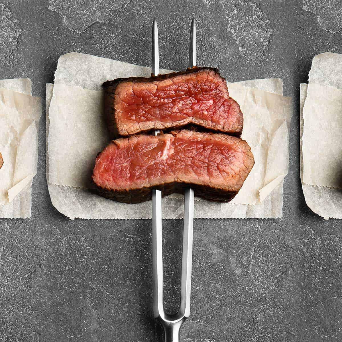 Medium rare steak on a beef fork