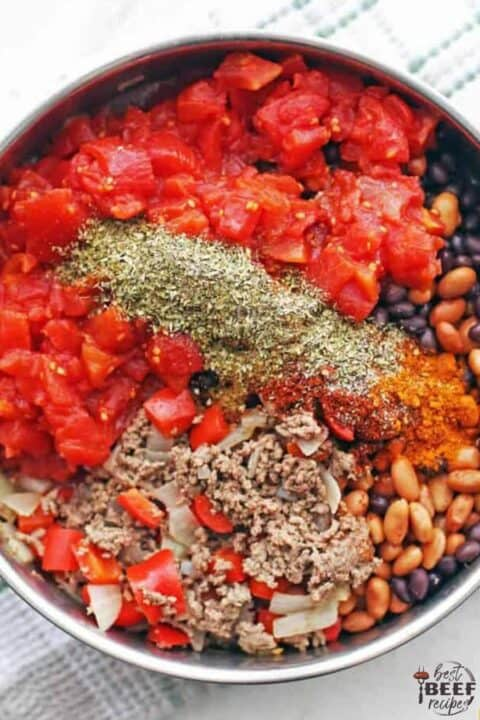 Ground beef chili ingredients in pot