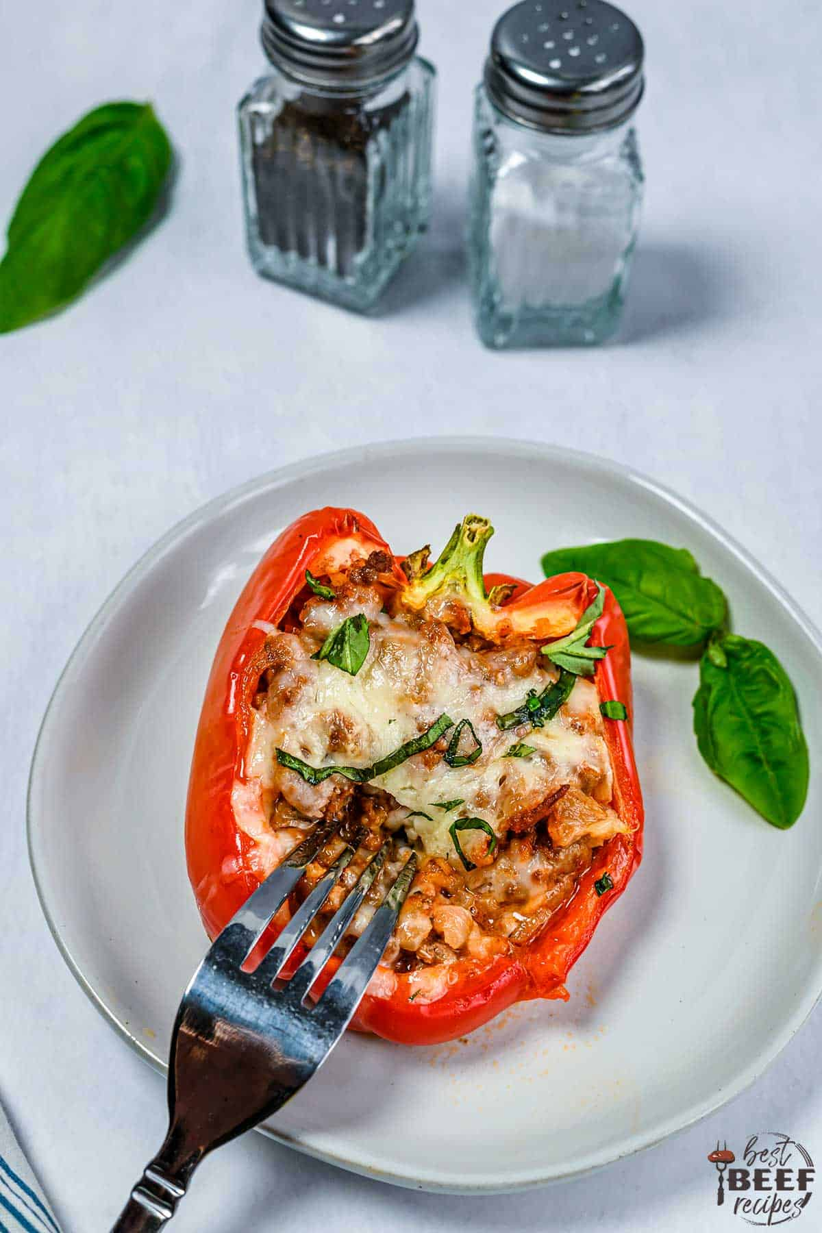 Stuffed bell pepper on a plate with a fork