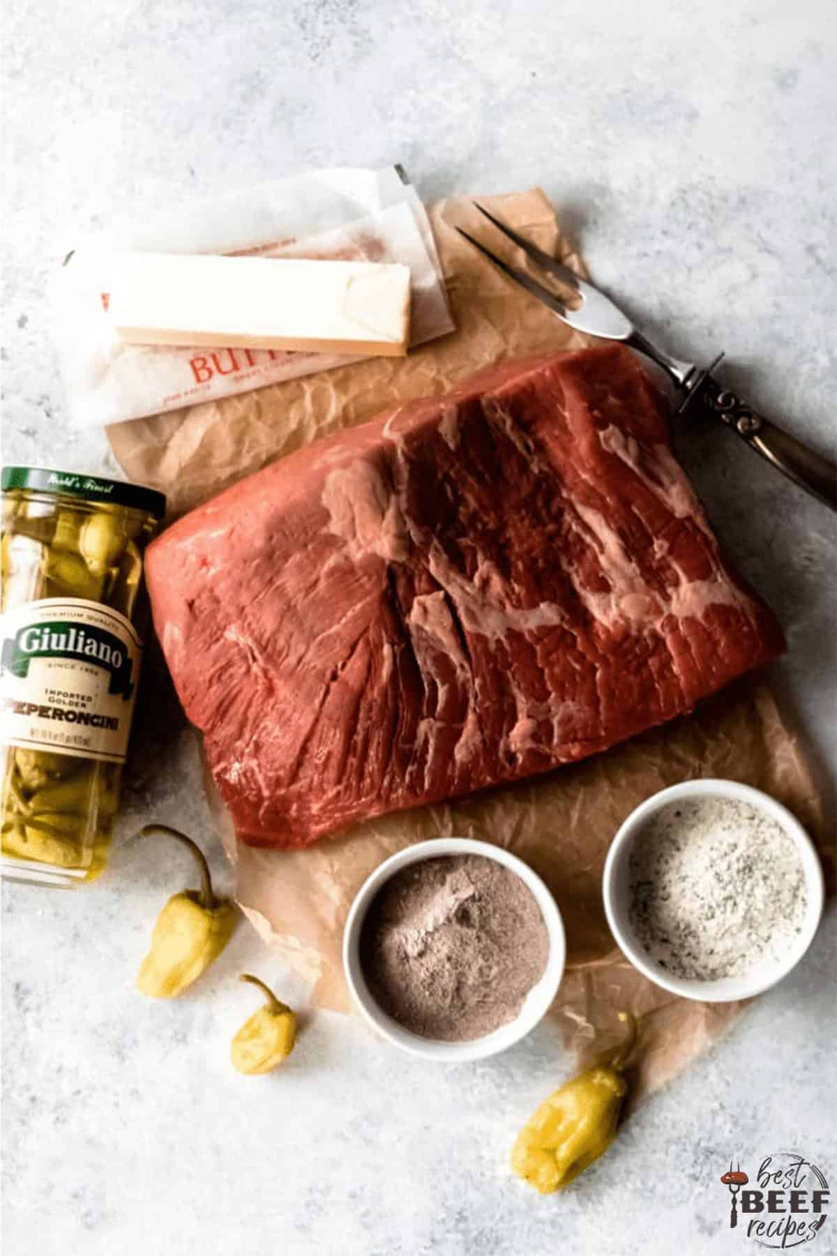 Ingredients to make slow cooker mississippi roast on a white surface