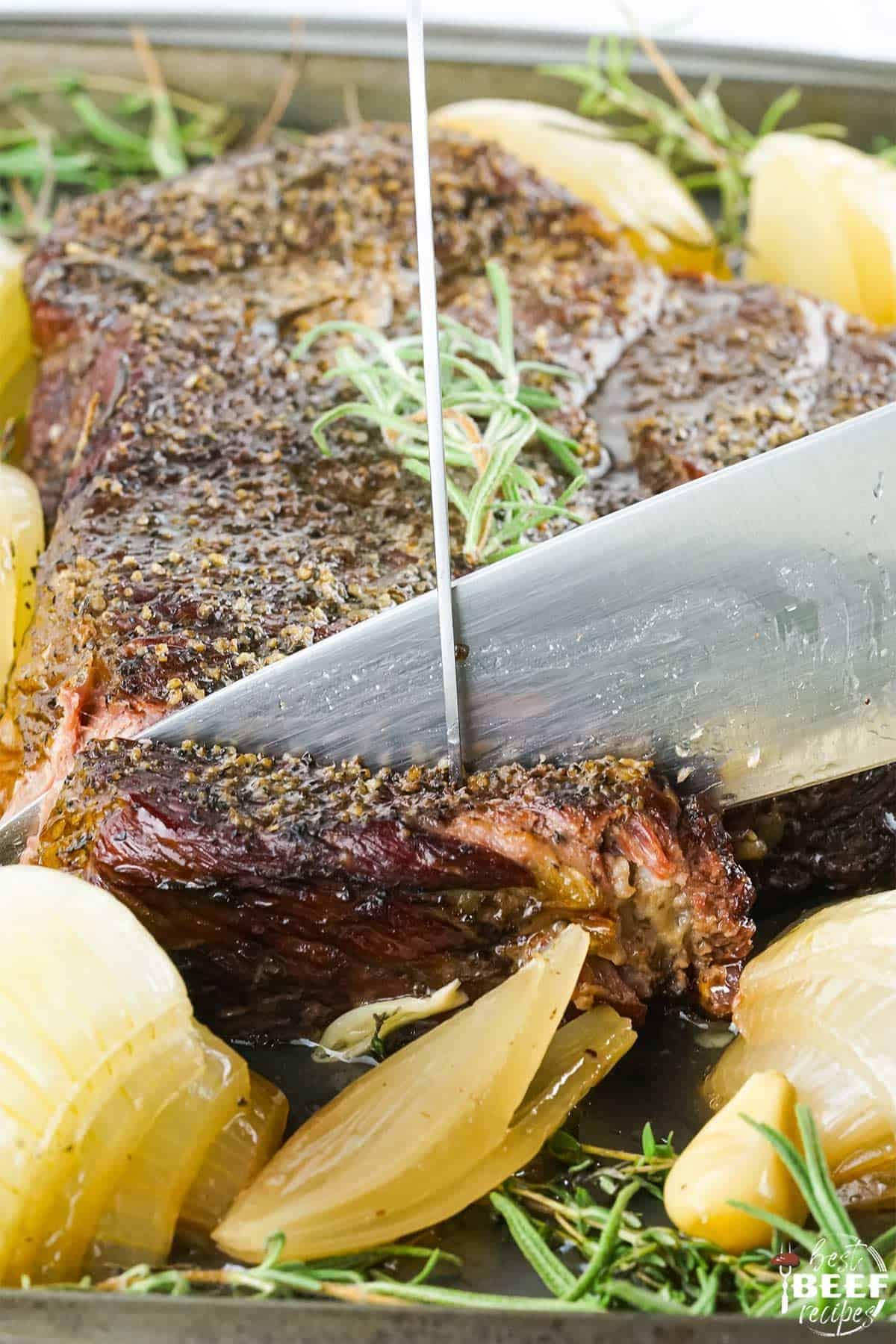 Slicing into a smoked chuck roast