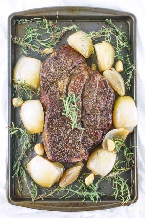 Whole smoked chuck roast on a tray