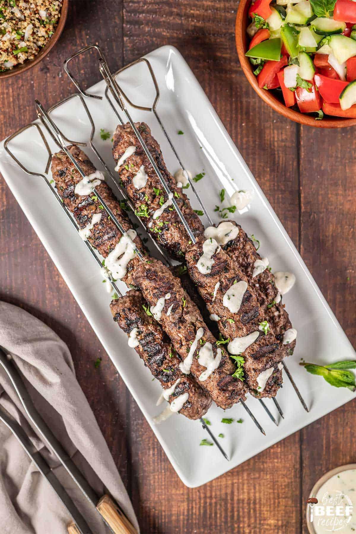 Kofta kebabs on a white platter