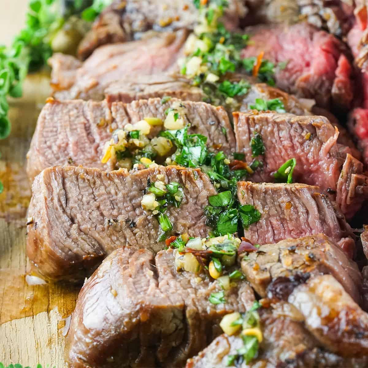 Slices of grilled porterhouse steak up close