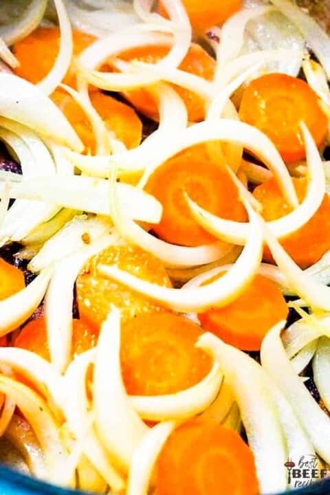 onions and carrots cooking in pot