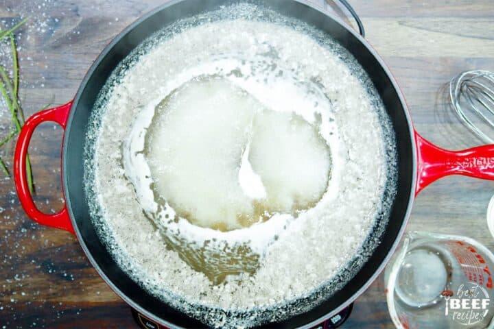 Simmering au jus in a pan