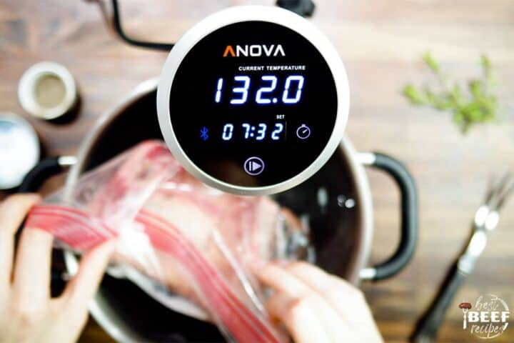 Sous vide cooker showing temperature of water for prime rib
